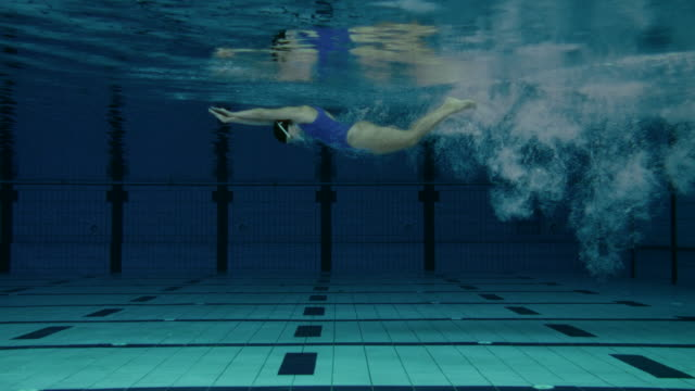 Female Swimmer Jumping Into Pool video