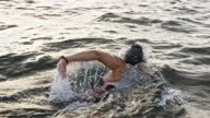 istock SLO MO Female swimmer swimming front crawl in choppy waters 1030961000