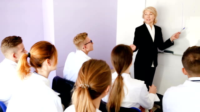 female teacher lecturing to medical students video