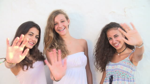 Female Teenage Friends Waving At Camera In Slow Motion video