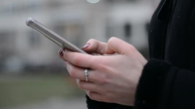 Female Teenagers people using mobile phones video