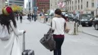 istock Female tourists exploring international city 1218659203