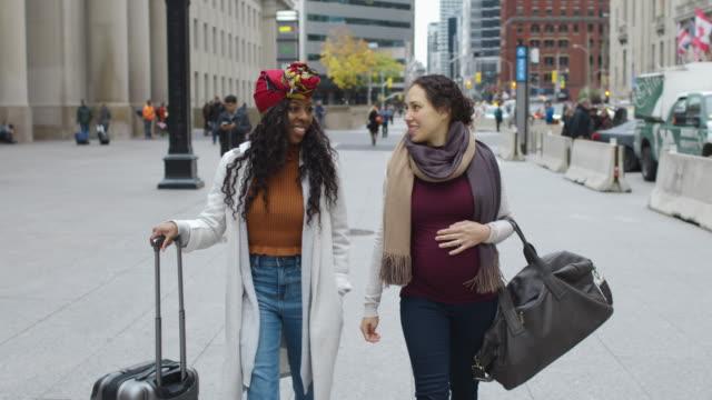 Female tourists exploring international city