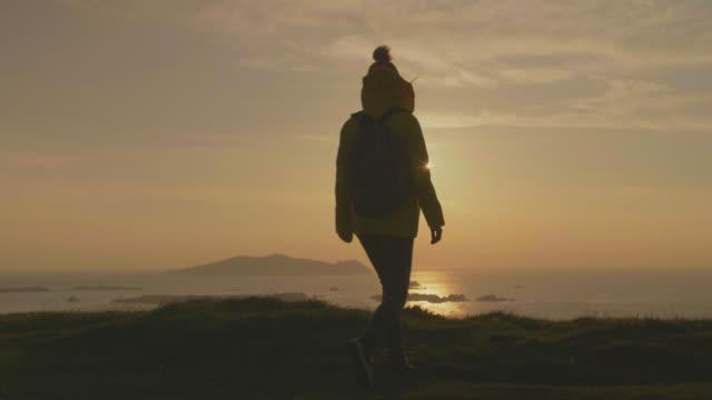 Female Traveler Enjoying Sea View From Mountain Cliff During Sunset video