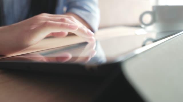 Female using her digital tablet.