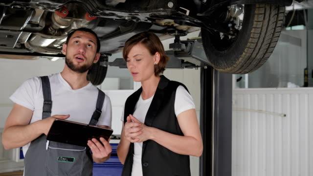 female vehicle breakdown, Car service, Professional maintenance people concept, car's service worker Advised client, helps feminine video