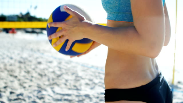 Female volleyball player holding volleyball 4k Female volleyball player holding volleyball at beach 4k beach volleyball stock videos & royalty-free footage