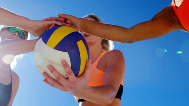 Female volleyball players forming hand stack 4k Female volleyball players forming hand stack 4k beach volleyball stock videos & royalty-free footage