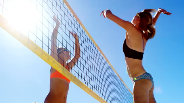 Female volleyball players playing volleyball 4k Female volleyball players playing volleyball at beach 4k volleyball sport stock videos & royalty-free footage