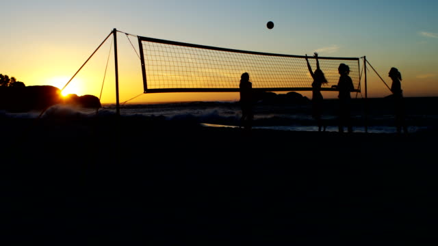 Female volleyball players playing volleyball 4k Female volleyball players playing volleyball in the beach 4k beach volleyball stock videos & royalty-free footage