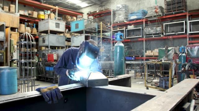 Female Welder Female Welder n Factory in Industrial Factory power tool stock videos & royalty-free footage