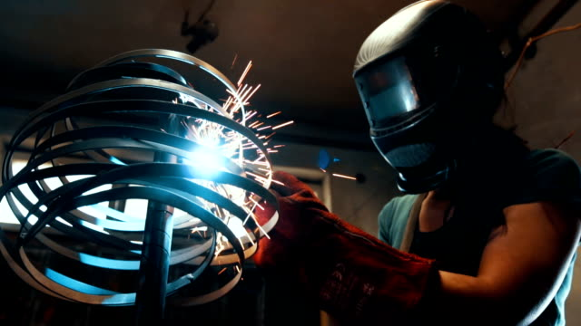 Female welder work with welding machine There are two woman and one man, they are in their shop, working together. metal worker stock videos & royalty-free footage
