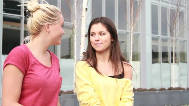 Female whispering in ear friend video