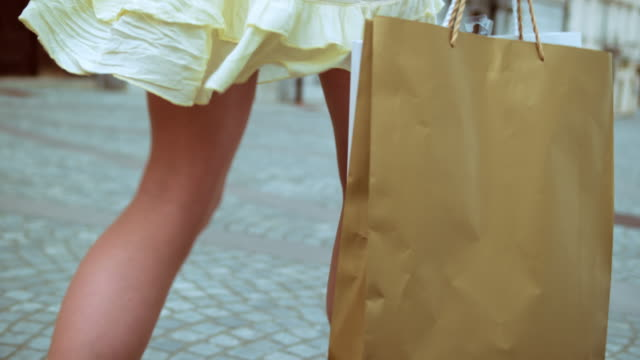 SLO MO Female with shopping bag walking on the street video