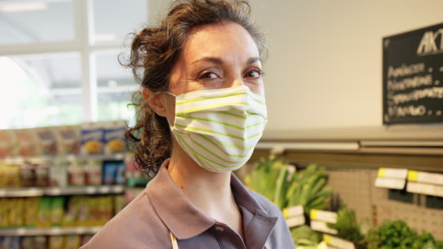 Female worker at grocery store during covid-19 pandemic