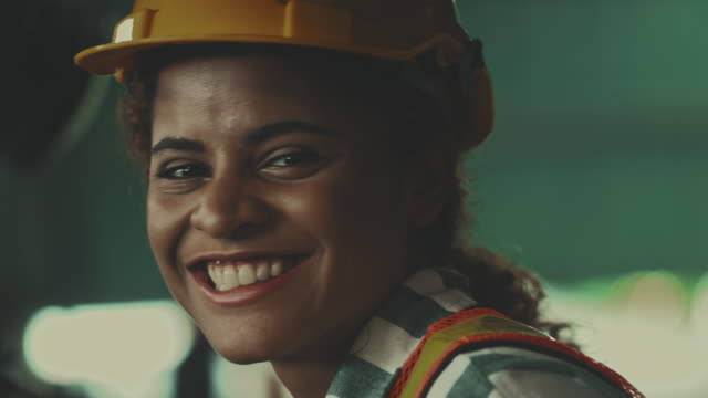 Female worker driving on a forklift. Warehouse