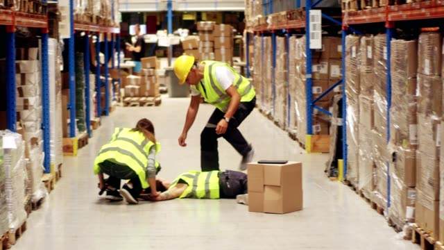 female worker falling down in warehouse - incidente video stock e b–roll