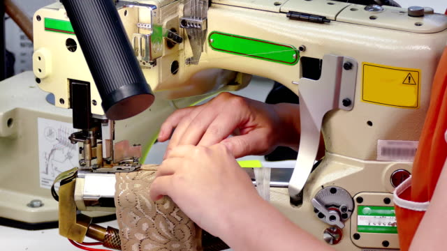 Female Worker Works for a Sewing Machine video
