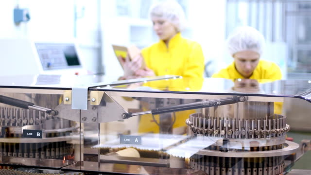 Female Workers At Pharmaceutical Factory video