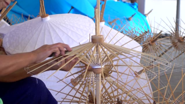 Female working handmade umbrella.