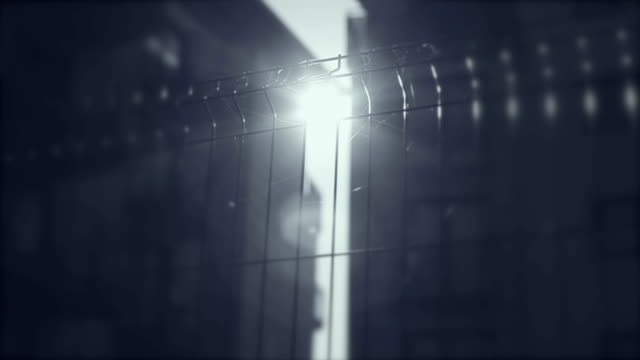 Fence, gate, grille, rays of the sun, apartments in the background video