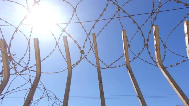 fence with barbed wire - prigione video stock e b–roll