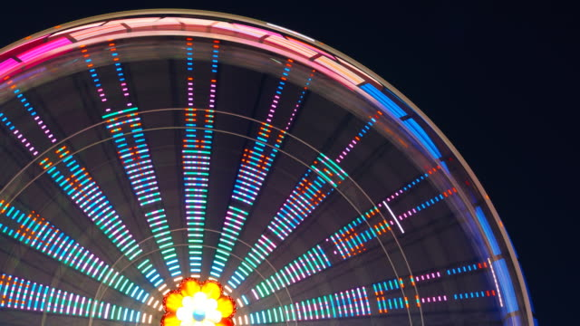 Ferris wheel at an amusement park turning during the night video