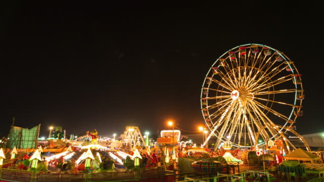 Ferris Wheel, Carnival Rides and Games at Night video