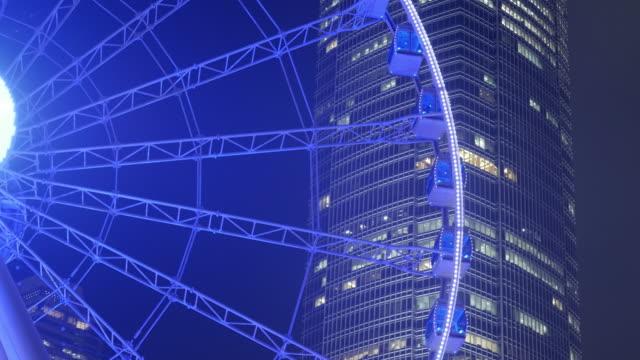 Ferris wheel in Hong Kong City at night