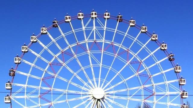 Ferris wheel on the blue sky in hd. video