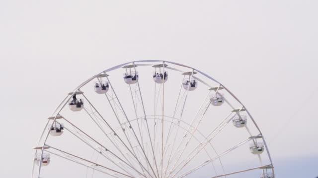 Ferris wheel. Overcast sky