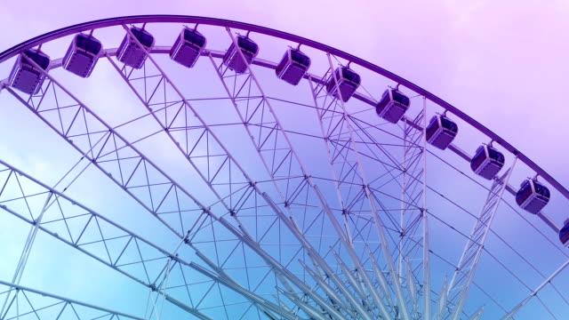 Ferris wheel spinning by night video