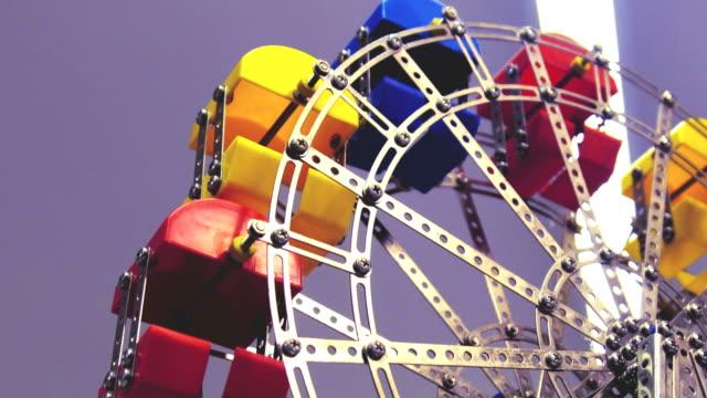 vídeos de stock e filmes b-roll de ferris wheel toy panoramic observation wheel colorful bottom view background - padrão repetido