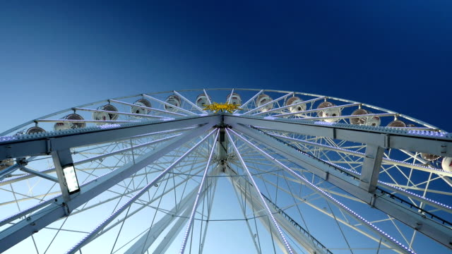 Ferris wheel with clear blue sky background. video