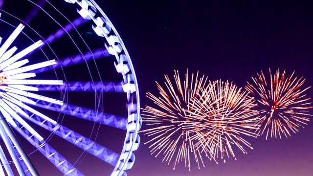 Ferris wheel with fireworks video