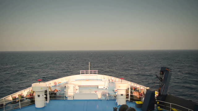 Ferry boat travelling in the middle of the ocean. Destination Paros island in Greece. View from the front of the ship Ferry boat travelling in the middle of the ocean. Destination Paros island in Greece. View from the front of the ship aegean islands stock videos & royalty-free footage
