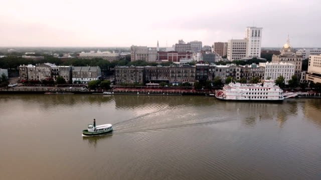 Ferry Boats Move Across the Savannah River from Downtown