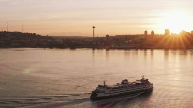 Ferry heading towards Seattle at sunrise. video