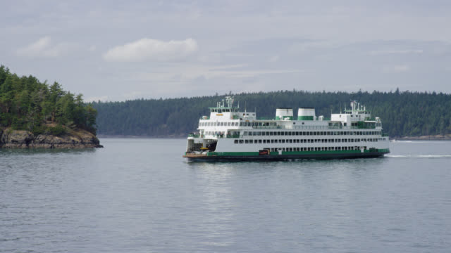 A Ferry Ship Sails From Friday Harbor to San Juan Island, Washington in the San Juan Channel on a Partly Cloudy Day