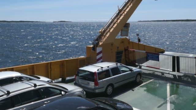ferry transportera bilar på östersjön på solig dag pov - ferry lake sweden bildbanksvideor och videomaterial från bakom kulisserna