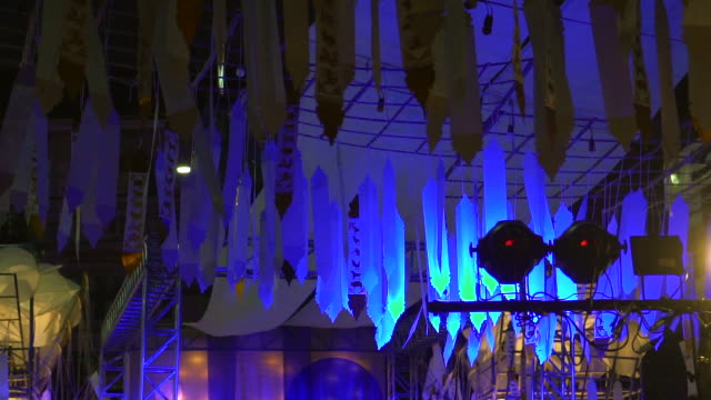 festival flags hanging with blue light, Thai style night market video