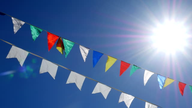 Festive bunting flags. Wind, Banner - Sign, Summer, Flag, Blowing carnival celebration event stock videos & royalty-free footage