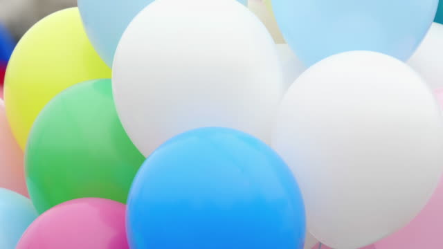 Festive color helium balloons. Many helium colorful balloons flying in the air. Celebration and birthday concept. birthday background stock videos & royalty-free footage