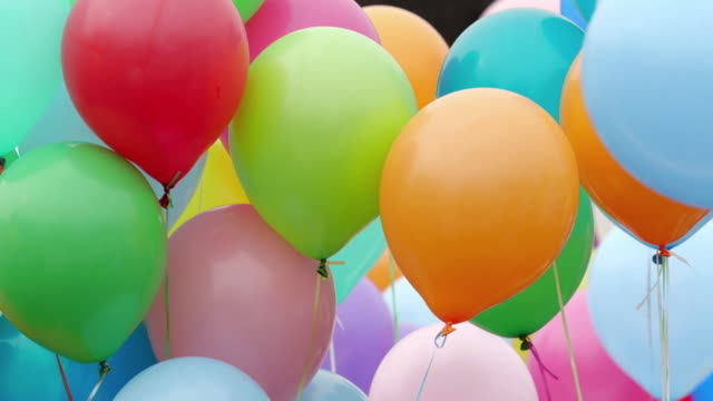 Festive color helium balloons. Many colorful balloons flying in the air. Celebration and birthday concept. happy birthday stock videos & royalty-free footage
