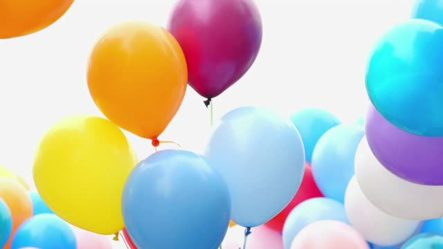 Festive color helium balloons. Many colorful balloons flying in the air. Celebration and birthday concept. birthday background stock videos & royalty-free footage