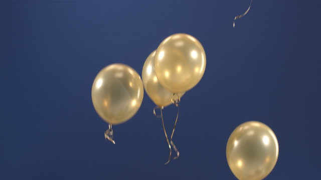 Festive decoration - balloons - appear in the video as a gift for the holidays: Valentine's Day, Birthday, Christmas, a festive event or New Year on a blue background. video