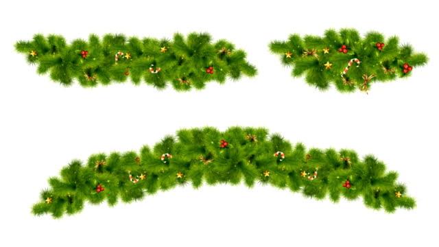 festliche elemente mit tannenzweigen, dekorationen, süßigkeiten, sternen und stechpalme mit alpha matte wünschen ihnen ein frohes weihnachtsfest und ein gutes neues jahr - girlande dekoration stock-videos und b-roll-filmmaterial