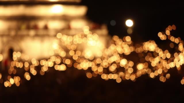 Festive lights sparkle and glitter bokeh background, Defocused bokeh illumination light celebration, Golden Abstract defocused dot