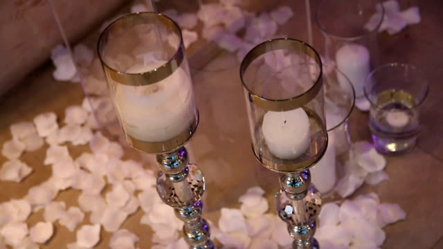 Festive wedding decor in the restaurant with flowers and candles video