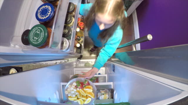 Fetching Fruit from the Fridge Little girl is opening the fridge at home to get a plate of fruit. fridge stock videos & royalty-free footage